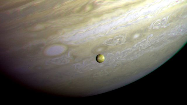 Jupiter And Io Photographed By Voyager 2